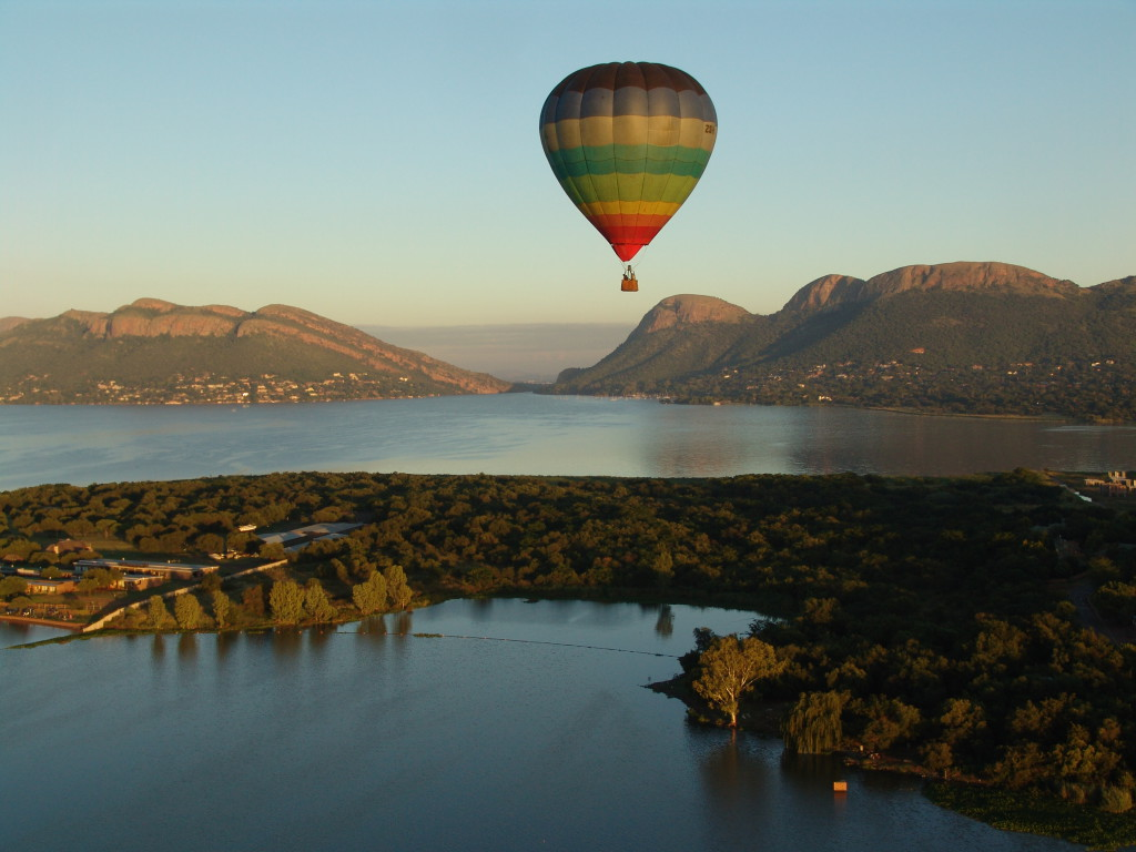 One of the hot air balloons from Magaliesburg going over the Harbeespoort Dam